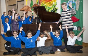 Norbury School choir celebrate the arrival of a special piano
