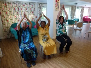 Susan taking part in a seated yoga class at St Barnabas